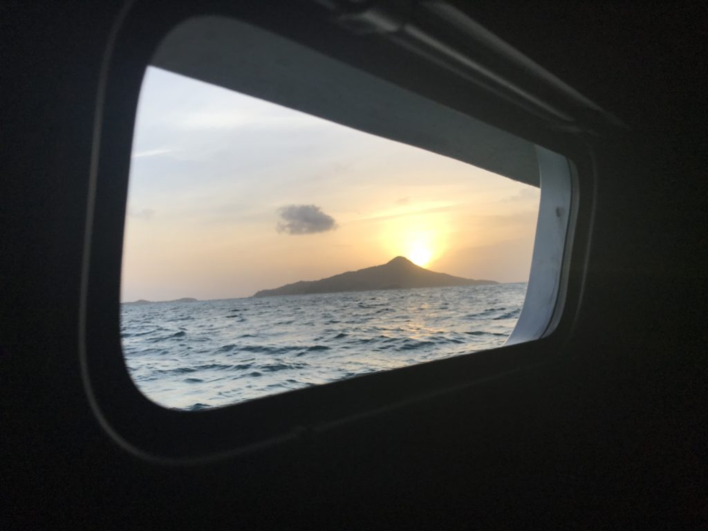 Morning view to Petite Martinique from a sailing catamaran